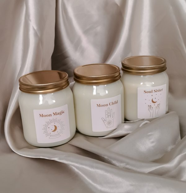 three scented candles on silk background