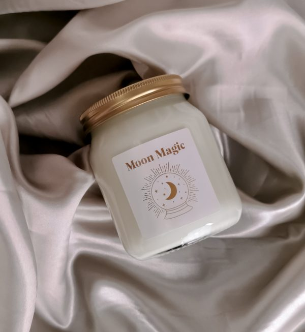 scented candle on silk background
